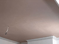 Tooting plasterer havng plasterboarded the ceiling applies a smooth 2 coat plaster finsh