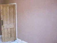 The Earlsfield plasterer plastering lounge walls in SW18