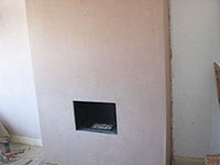 The Raynes Park Plasterer plastering a lounge fireplace in SW20